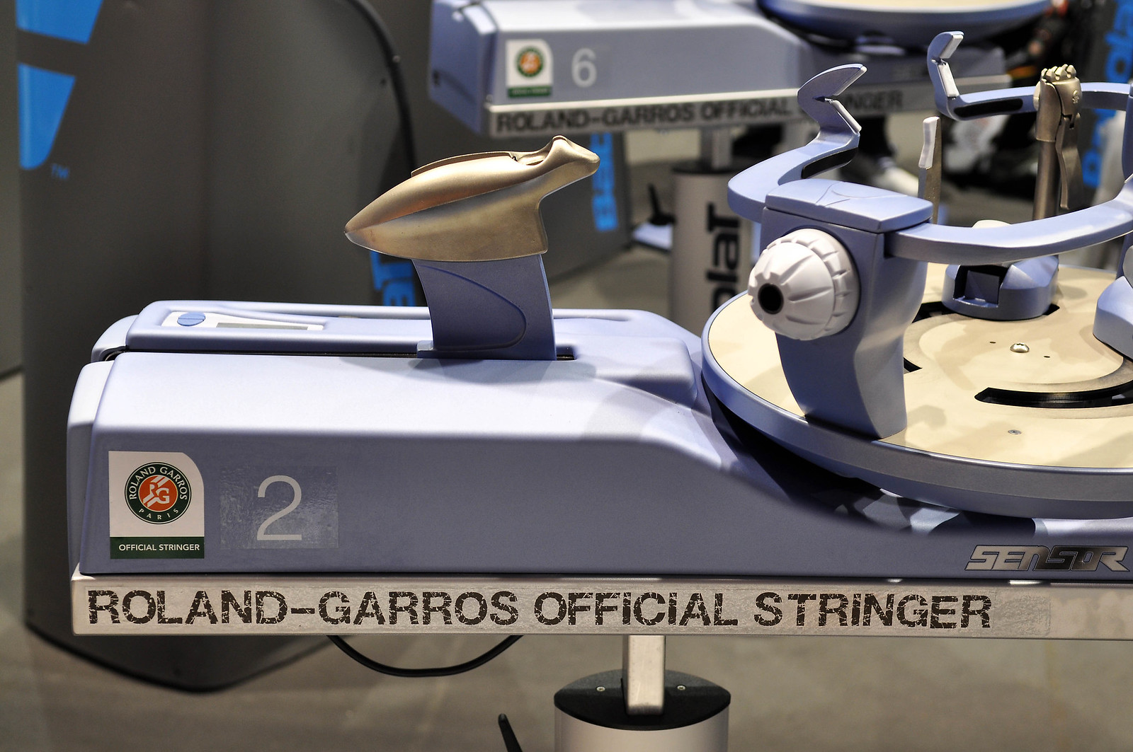 Should I string my own racquets (and buy my own stringing machine)?